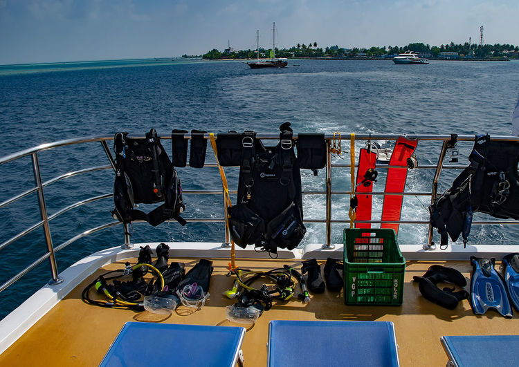 Scuba diving equipment drying in the sun on the deck of a dive boat Sky Day No People Drying Hanging Out Scuba Gear Equipment Gear Boat Boat Deck Maldives Indian Ocean Blue Sky Sun Sunshine Drying Out Dive Gear Dive Equipment Scuba Equipment Water Coast Holiday Diving
