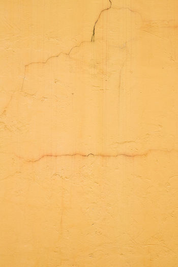 Architecture Backgrounds Beige Building Exterior Built Structure Close-up Cracked Damaged Day Full Frame No People Old Orange Color Outdoors Pattern Peeling Off Textured  Wall - Building Feature Weathered Yellow