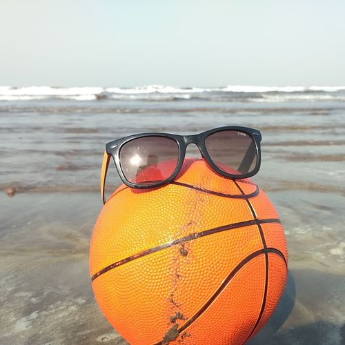 Beach Sea Sunglasses Sport Sand Summer Orange Color Eyeglasses  Water Ball Eyewear No People Outdoors Vacations Day Nature Close-up Swimming Sky Basketball - Sport