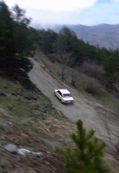 Stepantsminda, Kazbegi, Georgia Car Day Depth Of Field Escape Georgia Kazbegi Mountains Mountains Old Car Outdoors Stepantsminda White Car