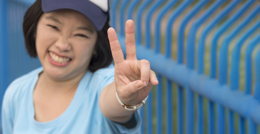 Portrait of teenage girl standing on mobile phone
