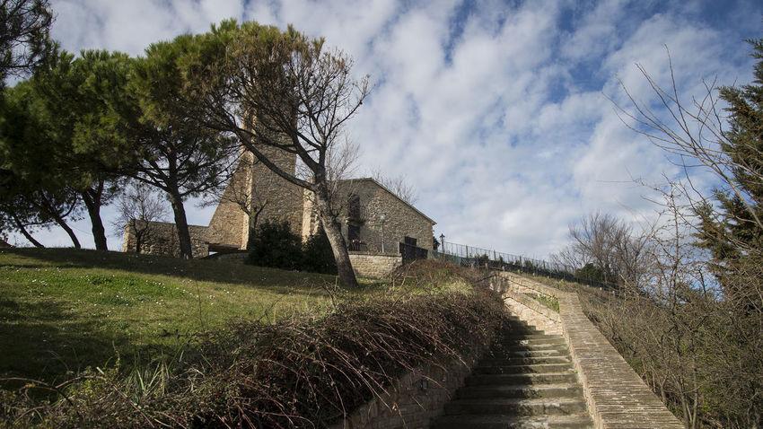 Sant'Andrea a Fiorenzuola di Focara Church Architecture Beauty In Nature Church Architecture Church Buildings Cloud - Sky Day Grass Sky Tree