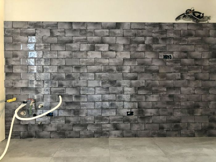 View of brick wall in bathroom