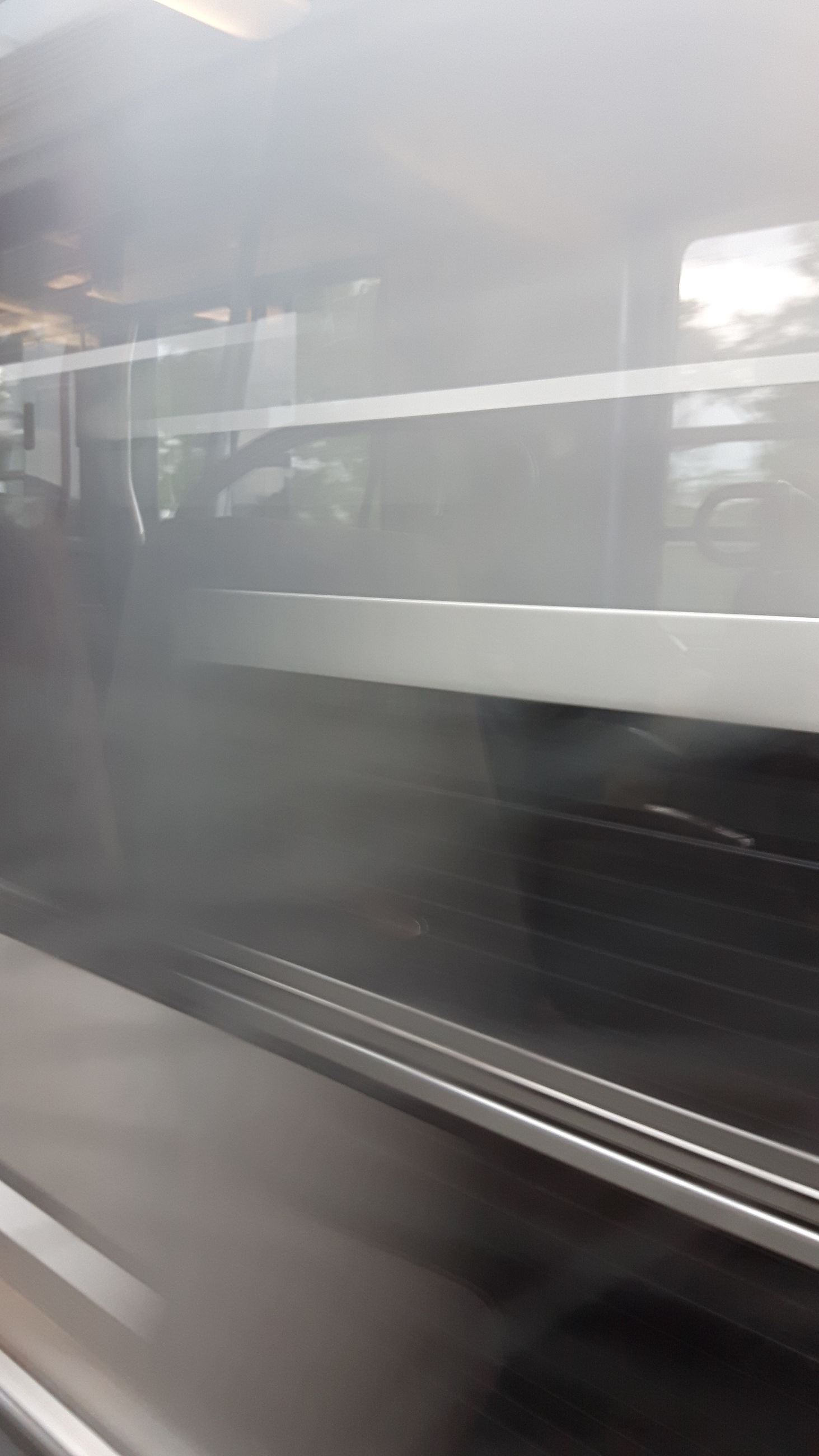 transportation, mode of transport, vehicle interior, glass - material, transparent, public transportation, window, train - vehicle, land vehicle, rail transportation, railroad track, on the move, travel, indoors, windshield, train, car, passenger train, motion, road