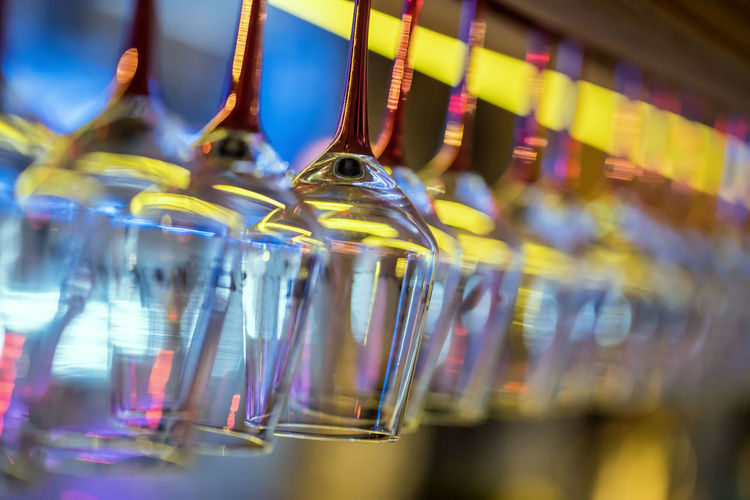 Bar - Drink Establishment Bar Counter Close-up Drink Drinking Glass Focus On Foreground Food And Drink Glass Glass - Material Group Of Objects Hanging In A Row Indoors  Large Group Of Objects Multi Colored No People Refreshment Selective Focus Still Life Transparent Wineglass