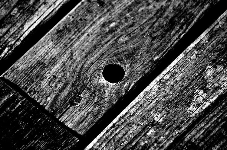 Abstract Wood Blackandwhite Grey Old Oldstyle Oldwood Oldwoodenstructure Abstract Abstract Photography Abstractart Art Art is Everywhere Close-up Close Up Wood - Material Hole Textured  Weathered Full Frame High Angle View No People Built Structure Outdoors Close-up Backgrounds