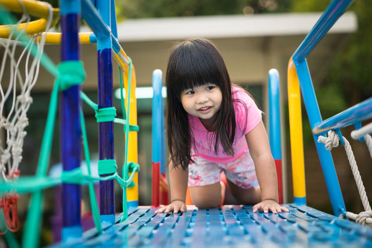 Smiling Girl Playing At Playground