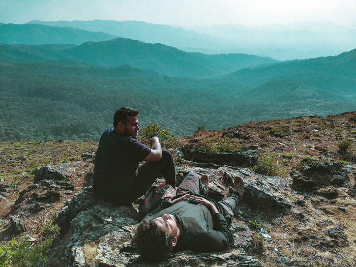 Friends Relaxing On Mountain