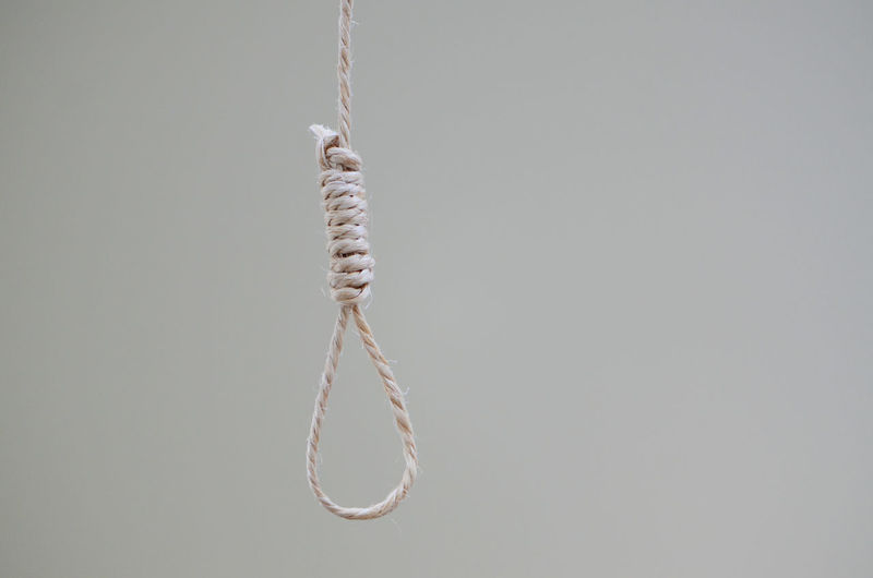 Hanging noose rope against white background