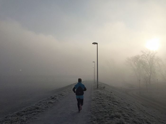 Rear view of athlete running in the morning