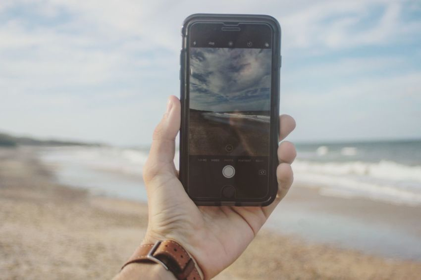 Perspective. Wireless Technology Holding Human Hand Communication Mobile Phone Smart Phone Portable Information Device Lifestyles Real People Photography Themes Photographing One Person Photo Messaging Beach Leisure Activity Technology Sea Water Sky Human Body Part IPhone IPhone7Plus Photography Austraila