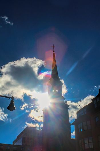 Sunlight causes a flair in my camera lens as I take a photograph of a church in Boston. Architecture Boston Building Exterior Built Structure Chruch City Cloud - Sky Clouds And Sky Day Flair Low Angle View No People Outdoors Sky Sun Sunbeam Sunlight