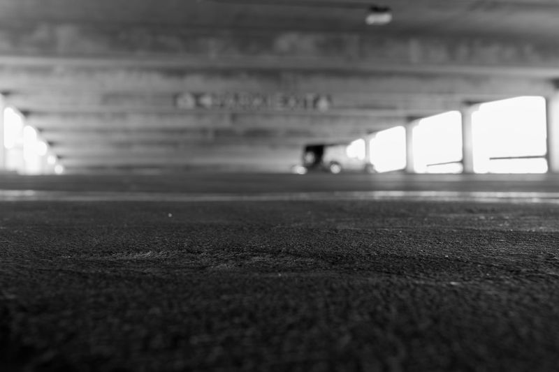 We parked. Alone Architecture Blackandwhite Brightlight Concrete Day Downlow Empty Places Exit Eye4photography  Feelinglow Helpless Inthedistance Jeep Monochrome Mypassion MyPhotography No People Outdoors Outoffocus Parking Garage Selective Focus Surface Level Tucson Monochrome Photography