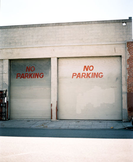 Architecture Building Exterior Built Structure Communication Corrugated Iron Day Door Doors Downtown Downtown District DowntownLA Garage Garage Door Losangeles No Parking No Parking Sign No People Outdoors Sign Signs Street Street Photography Streetphotography Text Western Script