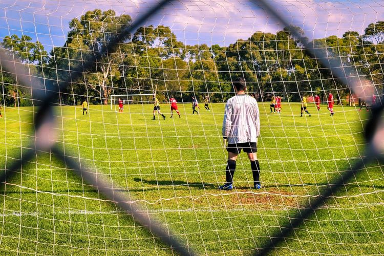 Soccer life Trees Soccer Player Soccer Field Soccer EyeEm Selects EyeEm Gallery Picoftheday Photography Real People Rear View Plant People Sunlight Men Grass Day Nature Leisure Activity Lifestyles Park Park - Man Made Space Full Length Shadow Standing Outdoors Adult Green Color
