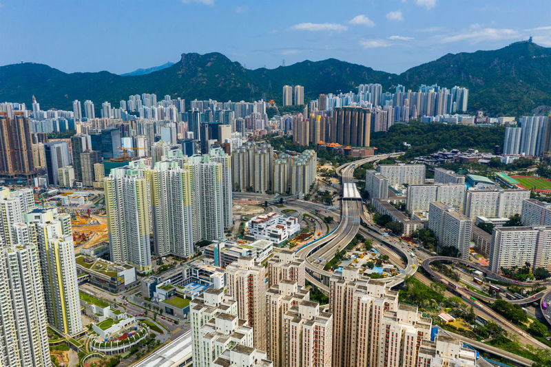 Top view of Hong Kong city Hong Kong Top View Hong Kong Building Kai Tak Kowloon Bay Side District Tall Apartment Real Estate Public House Lion Rock Mountain Skyline Cityscape Midtown Architecture Urban High Landmark Famous Downtown Skyscraper Sky Panorama Street Aerial Fly Drone  Over Above Down Top Down Bird Eye Hk City