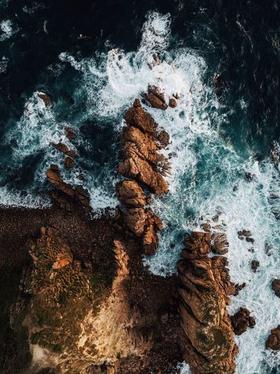 Jurassic. Used to live about an hour from this location before moving to Portland but this was the first time shooting with a drone here. The red rocks contrast beautifully with the blue sea here and it's a perspective that can't be missed. Find me on IG @noeldxng Australia Landscape Drone  Aerial View Travel Phillip Island Rock Formation Coast Coastline Adventure No People Backgrounds Water Full Frame Close-up Sky Rough Eroded Rocky Coastline Rock Geology Cliff Physical Geography The Great Outdoors - 2018 EyeEm Awards A New Beginning