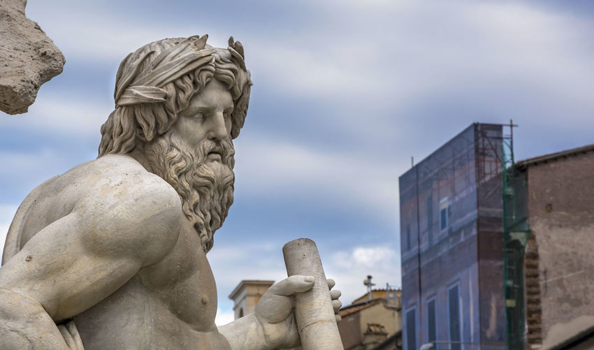 Piazza Navona Rome Statue Angel Architecture Art And Craft Building Exterior Built Structure Cloud - Sky Craft Creativity Day Face History Human Representation Low Angle View Male Likeness Nature No People Representation Sculpture Sky Solid Statue Stone Material