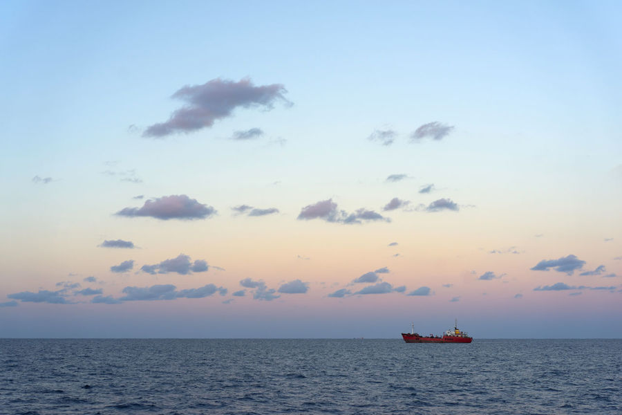 Cloud - Sky Evening Sky Mood Moody Sky Scenics Sea Sea And Sky Sea View Seascape Ship Ship At Sea Ship Transportation Shipping  Sky And Sea Skyporn Transportation Water Backgrounds Design Landscape