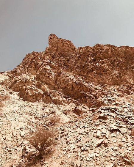 Arabian Moment Sky Tranquility Nature Tranquil Scene Day Beauty In Nature Scenics - Nature Non-urban Scene Land Rock - Object Environment Mountain Rock Formation Desert Landscape Low Angle View Rock No People Climate Clear Sky