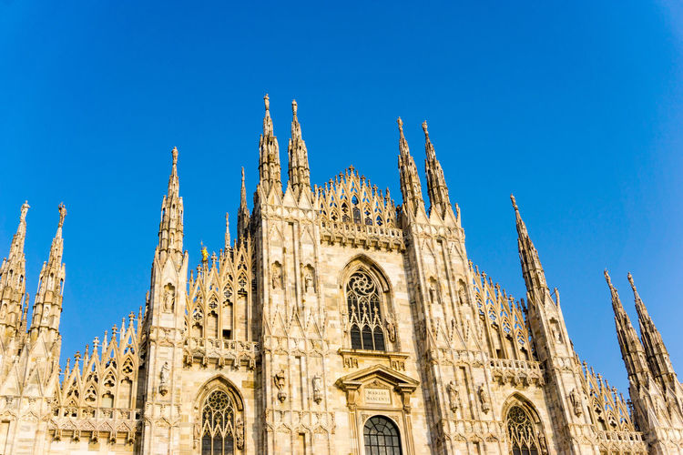 Low Angle View Of Duomo Di Milano Against Clear Sky