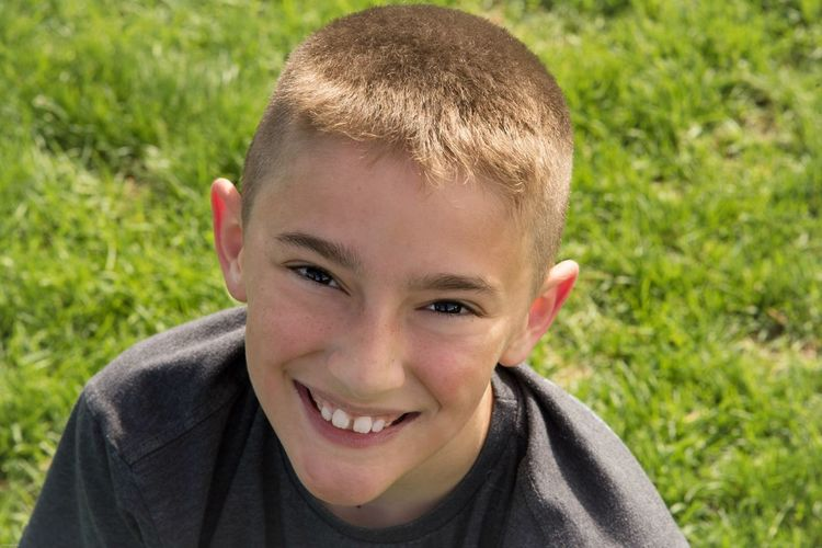 All smiles Portrait Headshot One Person Child Childhood Real People The Portraitist - 2018 EyeEm Awards Looking At Camera Males  Smiling Front View Lifestyles Boys Leisure Activity Day Close-up Field Outdoors