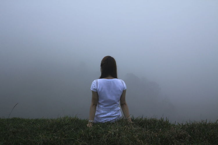 Rear View One Person Fog Real People Grass Leisure Activity Lifestyles Plant Land Women Solitude Beauty In Nature Tranquil Scene Tranquility Vacations Nature Adult Trip Hairstyle Looking At View Foggy Foggy Landscape Foggy Weather The Portraitist - 2019 EyeEm Awards