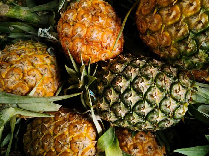 Close-up of pineapples for sale in market