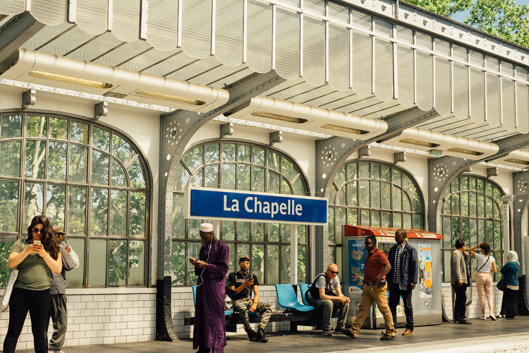 La Chapelle The Street Photographer - 2018 EyeEm Awards Adult Architecture Built Structure City Crowd Day Group Of People Men Mode Of Transportation Outdoors People Public Transportation Rail Transportation Railroad Station Real People Sign Text Transportation Travel Waiting Women