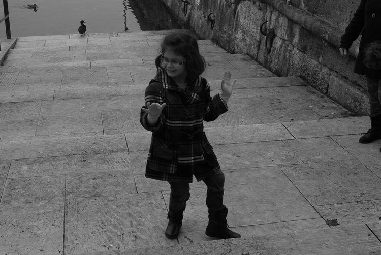 my daughter dancing in the street. Streetphotography Having Fun Taking Photos Enjoying Life Peoplephotography Switzerland EyeEm Kids Streetphoto_bw