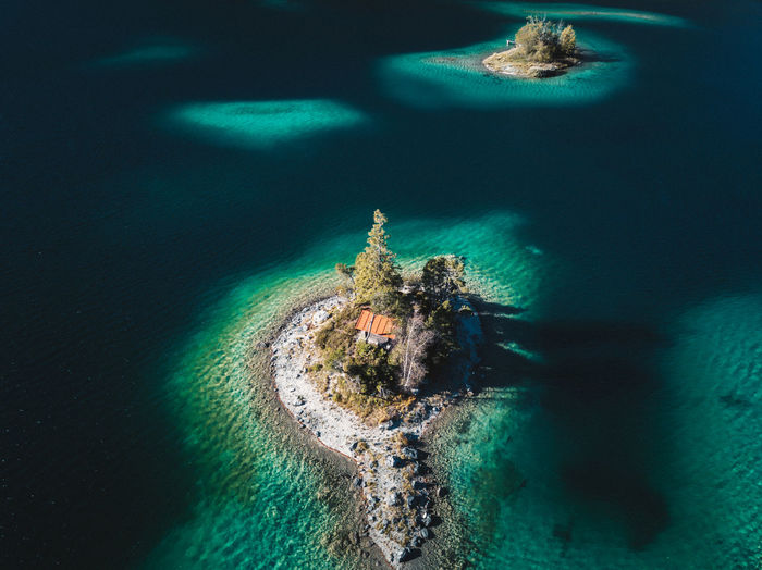 Water Sea Nature Beauty In Nature High Angle View Underwater Sport No People Turquoise Colored Day Outdoors Motion Ship Architecture Solid Nautical Vessel Rock Scenics - Nature Island Nature Tree Blue Clean Eibsee House