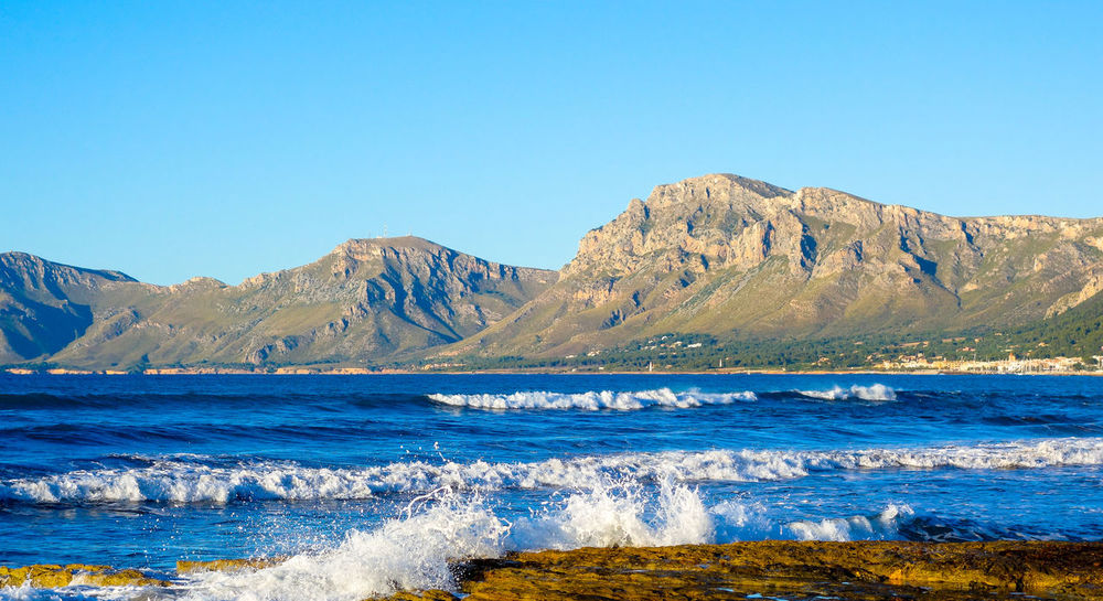 Alcudia Bay Beach Beauty In Nature Blue Clear Sky Colònia De Sant Pere Day Holiday Landscape Mallorca Mountain Mountain Range Mountains Nature No People Outdoors Refraction Scenics Sea Sky SPAIN Tranquil Scene Travel Destinations Water