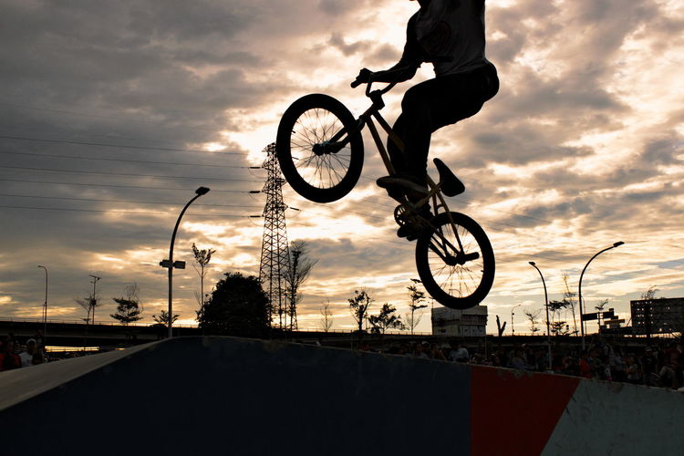 Power line grind. Adventure Bicycle Bmx Cycling Bmx Trick Cloud - Sky Cycling Day Extreme Sports Jump Men Mid Air Only Men Outdoors Sky Sport Stunt Sunset Wheelie