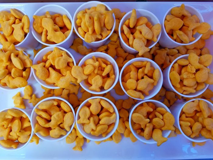 High Angle View Of Cups Of Fish Shaped Crackers
