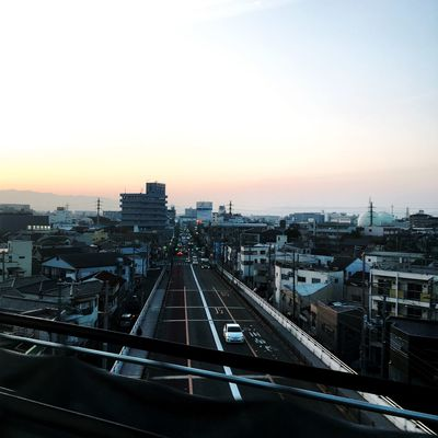 Architecture Building Building Exterior Built Structure Car City Cityscape Copy Space High Angle View Mode Of Transportation Motor Vehicle Nature No People Outdoors Rail Transportation Railroad Track Sky Sunset Track Transportation Travel