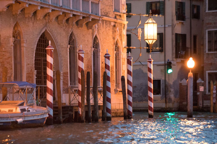 A Day in Venice Architecture Building Exterior Canal Illuminated Mooring Poles Night No People Red And White Stripes Travel Destinations Travel Photography Water