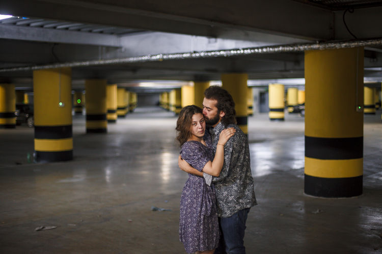 Couple embracing in parking lot