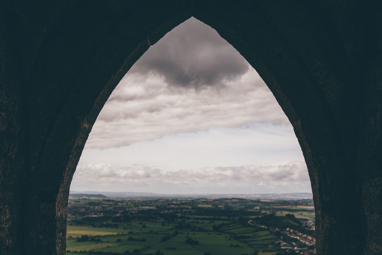 A view from Glastonbury Tor of a Somerset landscape, United Kingdom. Arch Cloud Cloud - Sky Cloudy Glastonbury Glastonbury Tor Hill Idyllic Landscape Mountain No People Non-urban Scene Overcast Remote Rural Scene Scenics Sky Tranquil Scene View View From The Window... Weather