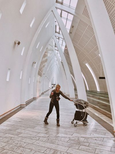 Airport Full Length One Person Architecture Indoors  Standing Adult Built Structure Real People Arts Culture And Entertainment Holding Day Shadow Travel Nature Ceiling Lifestyles Front View
