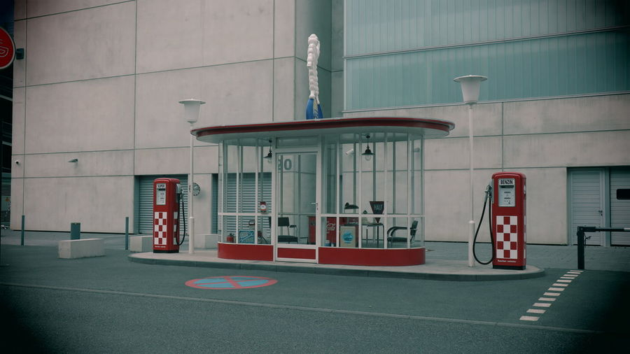 Old fashioned styled red and white gas station