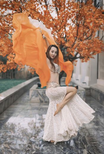 Portrait of beautiful woman standing against tree during autumn
