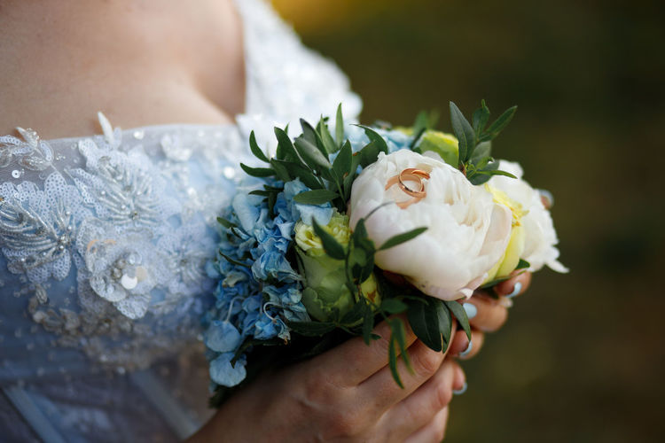 Beauty In Nature Bouquet Bride Event Flower Flower Arrangement Flower Head Flowering Plant Fragility Freshness Hand Holding Life Events Nature One Person Outdoors Plant Rose - Flower Vulnerability  Wedding Wedding Ceremony Wedding Dress Women