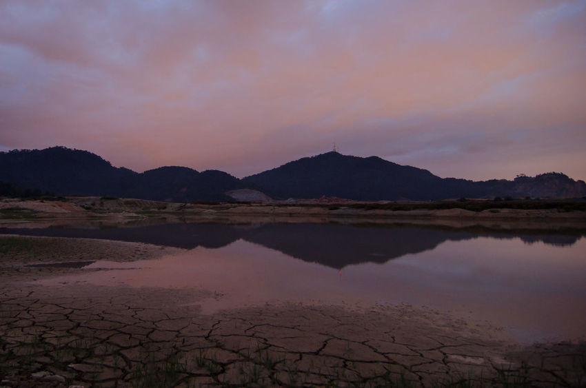 Reflection Mengkuang Dam in dusk hour. Arid Climate Beauty In Nature Day Desert Landscape Mengkuang Mountain Mountain Range Nature No People Outdoors Reflection Salt - Mineral Scenics Sky Sunset Tranquil Scene Tranquility Water