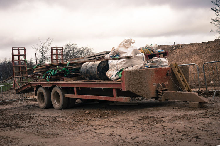 Agriculture Barrel Construction Day Disposal Farm Land Fill Land Vehicle Muddy No People Outdoors Rebar Reinforcement Bar Rural Scene Rustic Sky Tire Tractor Trailer Working