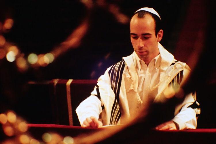 Rabbi reading book at synagogue