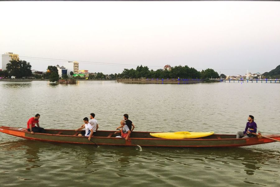 Nautical Vessel River Water Real People Men Oar Leisure Activity Clear Sky Outdoors Transportation Day Sitting Waterfront Rowing Medium Group Of People Women Tree Nature Togetherness Lifestyles Peace And Quiet Lake View Lakeside Peaceful Iran