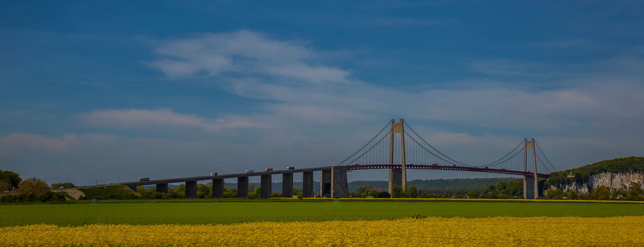 Beauty In Nature Bridge Bridge - Man Made Structure Cloud Cloud - Sky Connection France Honfleur Landscape Long Nature Outdoors Panorama Scenics Sky Travel Destinations Traveling Yellow Flower Yellow Flowers
