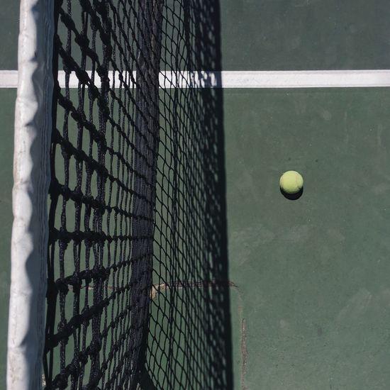 Maximum Closeness Sport Tennis Court Tennis Ball Tennis Net Ball No People Competition Outdoors Racket Sport Day