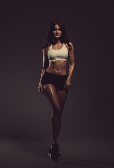 Young beautiful athletic woman, studio shot Athlete Athletic Bodybuilding Figure Adult Attractive Beautiful Woman Beauty Biceps Brunette Fitness Fitness Model Muscles Muscular Build One Person Physique  Sport Sportive Standing Strength Strong Studio Shot Women Young Adult Young Women