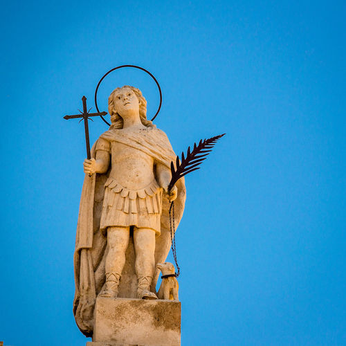 Blue Art And Craft Human Representation Sculpture Representation Sky Male Likeness Statue Clear Sky Creativity Nature Low Angle View Copy Space No People Architecture Craft Day Religion Spirituality Angel